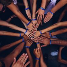 Image of team with hands in a circle